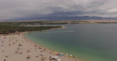 4K aerial shot DJI phantom 3 above beach at holiday at summer Stock Footage