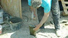 Hand shaping stone slab. Stock Footage
