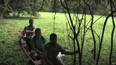 Wood Canoeing in the Rainforest of Amazon Basin PERU Stock Footage