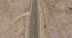 4K aerial shot DJI phantom 3 above an empty road, freeway by traveling Stock Footage