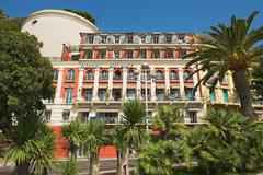 Exterior of the historical Hotel Suisse in Nice, France. - stock photo