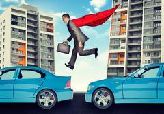 Businessman springing over cars Stock Photos
