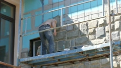 Facing building with stone slabs. Stock Footage