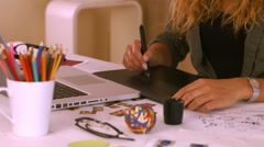 Graphic designer using digitizer at her desk Stock Footage