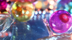 Blinking lightbulbs and christmas balls close-up Stock Footage