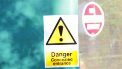 Danger Sign Pan to No Entry Sign - stock footage