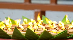 Lanna style candles burning Stock Footage
