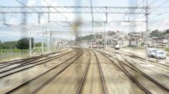 Train tracks that advances as seen through a window Stock Footage