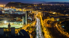 Elevated dusk view over Barcelona city centre, Catalunya, Spain - Time lapse Stock Footage