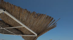 Thatched roof over blue sky - stock footage