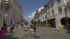 Young girls walking on Nicolae Balcescu Street in Sibiu Stock Footage