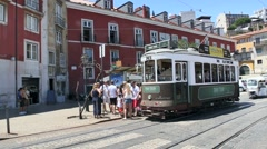 Old tramway stopping by largo das portas do sol, Lisbon Stock Footage