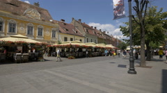Walking along the outdoor restaurants in Sibiu Stock Footage