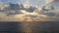 Sea and glorious sunset through clouds - stock footage