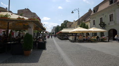 Outdoor restaurants on Nicolae Balcescu Street in Sibiu Stock Footage