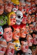 Traditional paper masks for New Year celebration in Ecuador Stock Photos