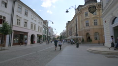 Families and other tourists walking on Nicolae Balcescu Street in Sibiu Stock Footage
