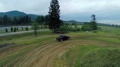 Air view on off road course with the driver in pick up - stock footage