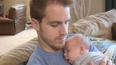 Newborn Baby boy asleep on father's chest - stock footage