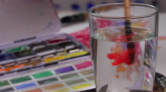 watercolor brush dipped in water - stock footage