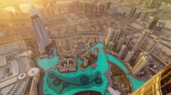 Sun light world highest building mall fountain roof top view 4k time lapse uae Stock Footage