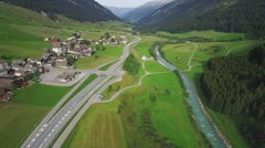 Flight along a mountain river village in front Stock Footage