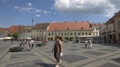 Riding bikes and walking in the Large Square, Sibiu Stock Footage