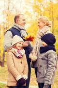 happy family in autumn park - stock photo