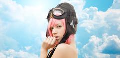 Pink hair girl in aviator helmet over blue sky Stock Photos