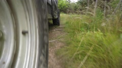 A low shot of a four wheeler side by side tires driving on dirt Stock Footage