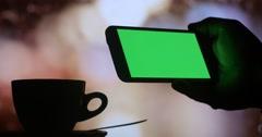 Using smart phone green screen drinking coffee tea Stock Footage