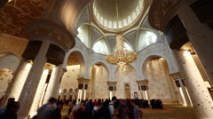 Famous main white mosque crowded inside interiour 4k time lapse uae Stock Footage