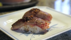 Wagyu beef slice seared, aburi guy sushi nigiri. Japanese food Stock Footage