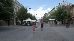 Little girl running on Nicolae Balcescu Street, Sibiu Stock Footage