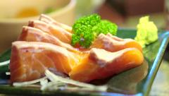 Video of salmon sashimi on restaurant decorated platter, Japanese food Stock Footage