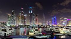 Sunset night dubai marina yacht dock beach panorama 4k time lapse uae Stock Footage