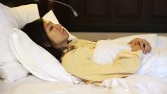 Video worried asian woman in bed, insomnia and thinking about life - stock footage