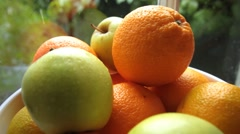 Bowl of oranges and  green apples Stock Footage