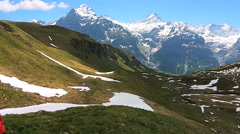 Stock Video Footage of aerial drone female tourist eco tourism hiking Switzerland Alps outdoor sport