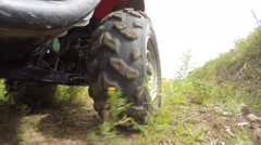 Low shot of a four wheeler side by side tire driving on dirt - stock footage