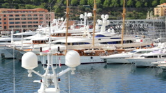 French Riviera Monaco marina city luxury yacht harbour transport wealthy living Stock Footage
