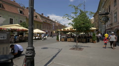 Outdoor restaurants in the city center of Sibiu Stock Footage