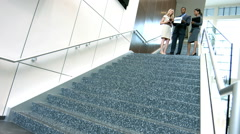 Young multi ethnic business people with wifi technology on office atrium - stock footage