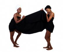 Two Black Sisters Standing Wrapped In Cloth - stock photo