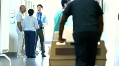Asian American male doctor consult with patients and team work in medical centre Stock Footage