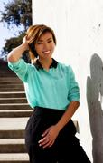 Smiling Skinny Asian American Woman Standing Outdoors Stock Photos