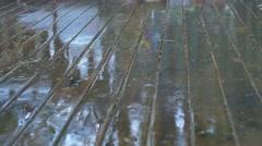 Wet Weather Rain Drops Splash on Wood Surface - stock footage