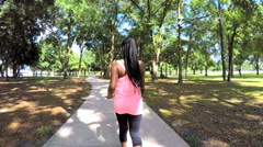 Young slim African American female power walking outdoor - stock footage