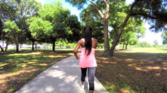 Young happy African American girl power walking to keep healthy Stock Footage