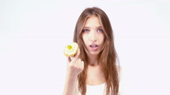 Cheerful girl eating cake Stock Footage